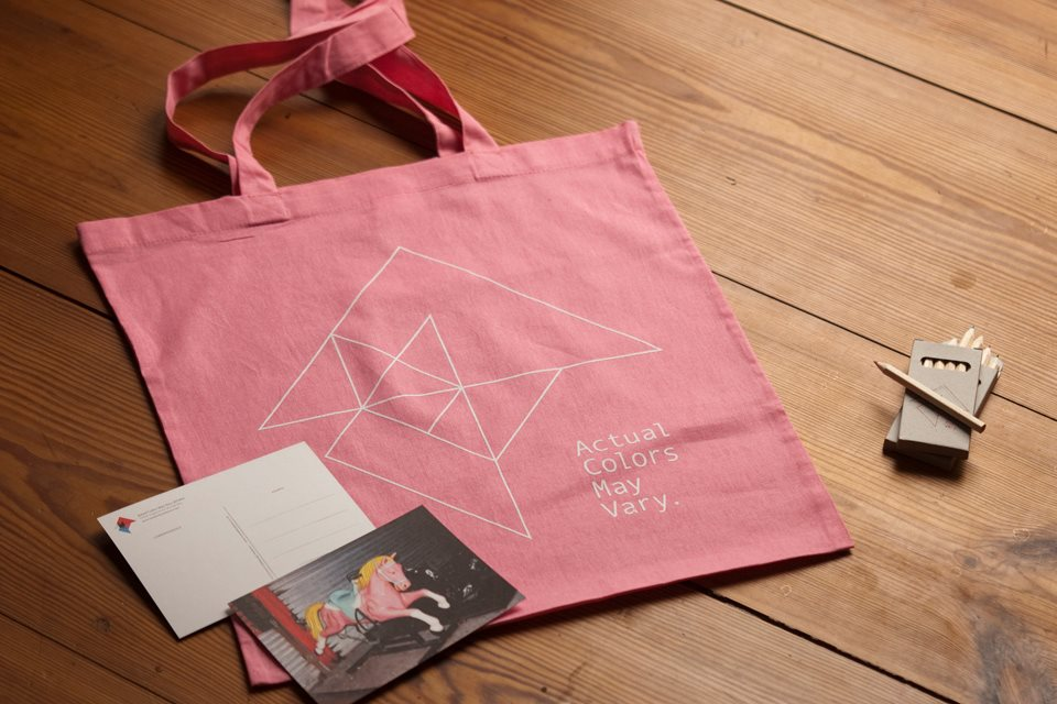 ACMV's screen printed tote bags, postcards feat. a photo by Maxwell Anderson, and hand-signed pencils
