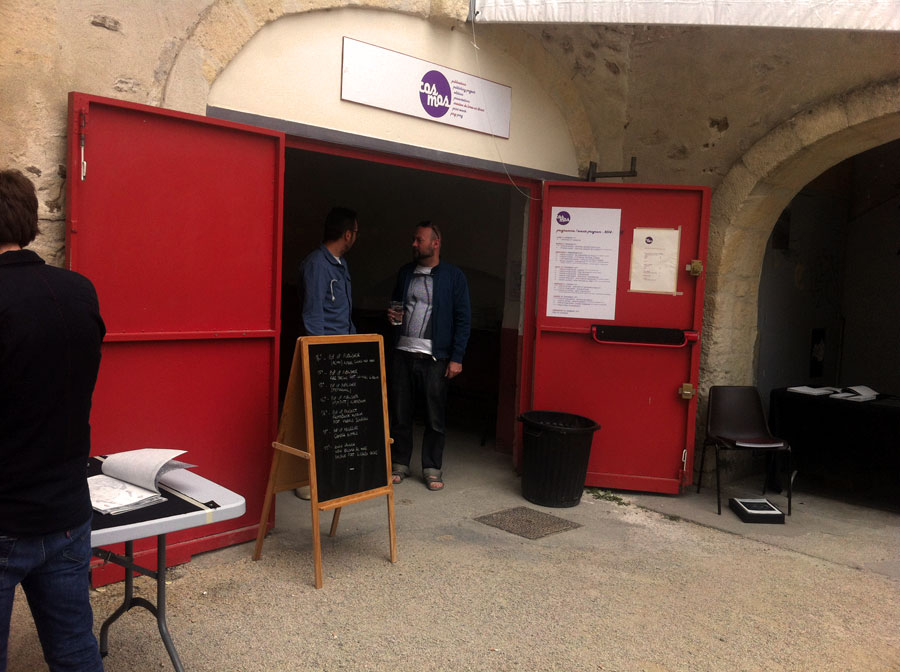 ACMV's table at at COSMOS, during the opening week of Les Rencontres d'Arles, 2014